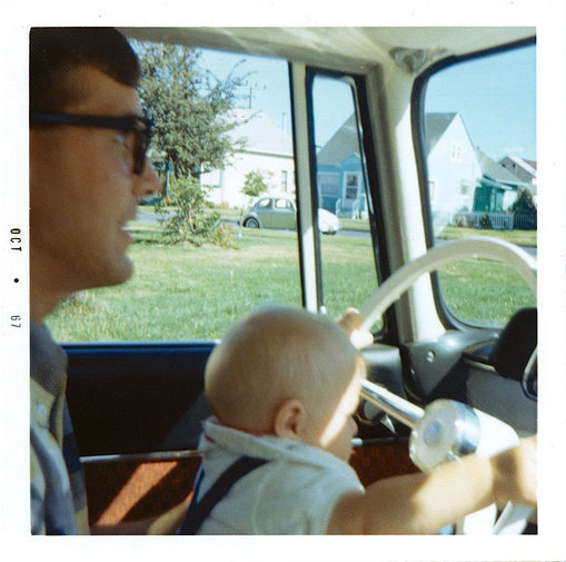 "Kurt ""driving"" at 5 months (wit his dad, Don)"