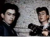 A young George Harrison with a young John Lennon