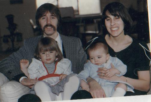 Here, I put an old picture of my family up,  Pictured are:Katie (me) on my father and Dan (my brother) on my mother